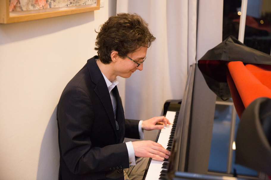 Fellow Andrew Hicks Plays Piano At The Reception Of The Spring 2018 Fellows Presentation. Photo: Annette Hornischer
