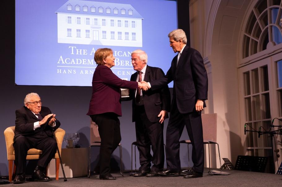 Chancellor Angela Merkel congratulated by Gerhard Casper and John Kerry. Photo: Annette Hornischer